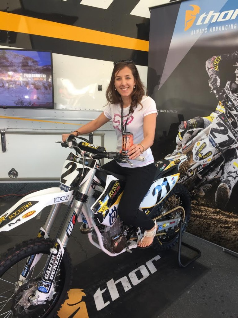 Nicole taking a seat on Jason Anderson's Husqvarna 450 in the Anaheim pits.